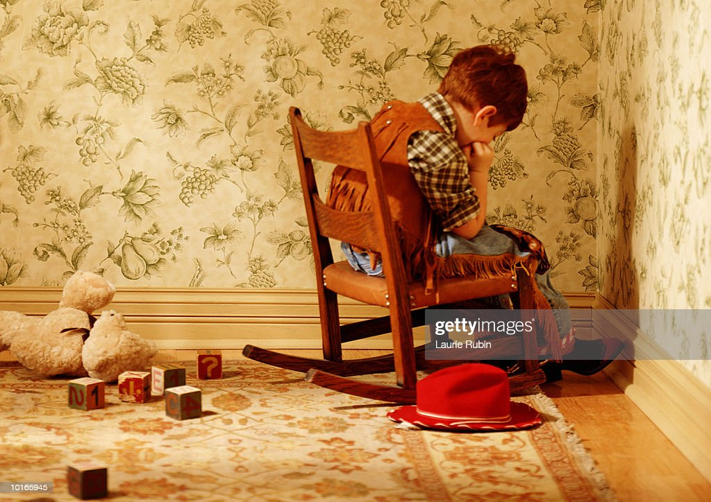 YOUNG BOY IN CORNER