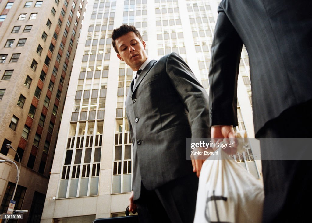 TWO BUSINESSMEN WITH MONEY BAGS : Stock Photo