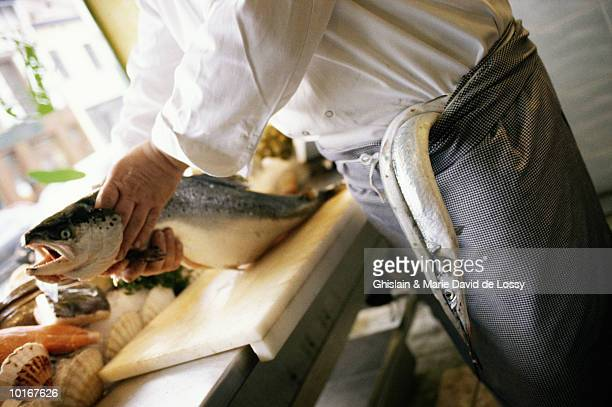 FISHMONGER AT WORK