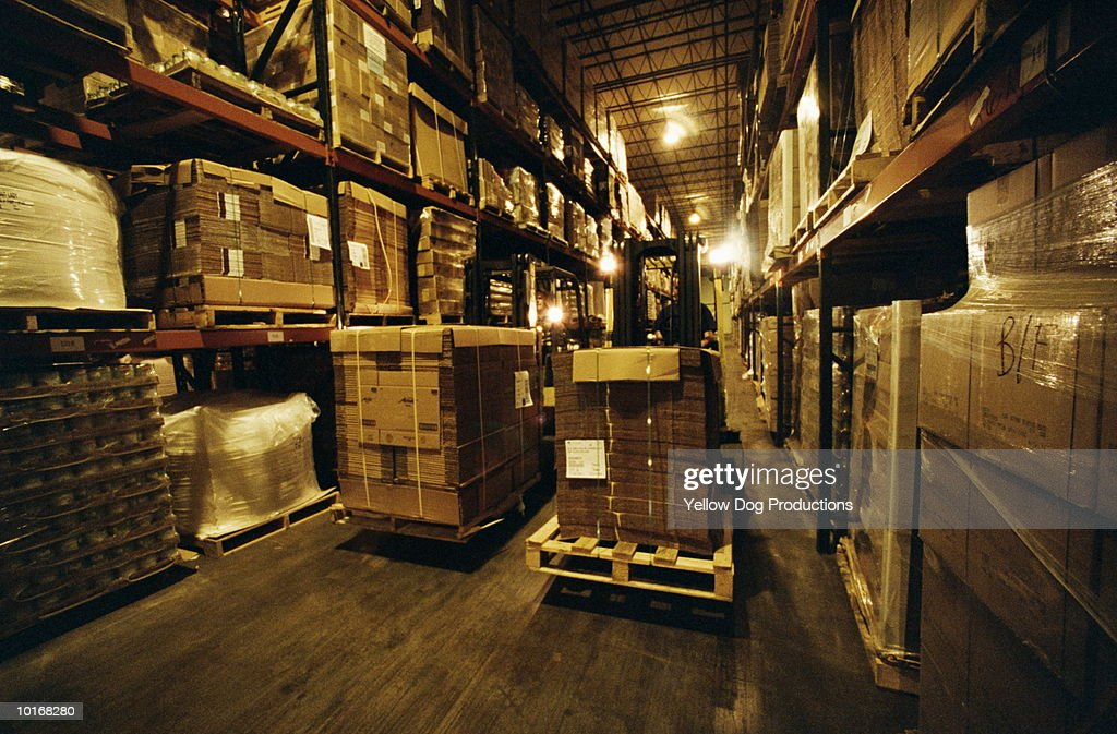 FORKLIFTS IN WAREHOUSE : Stock Photo