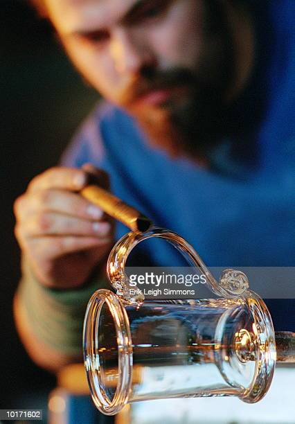 MAN SHAPING HANDLE ON GLASS