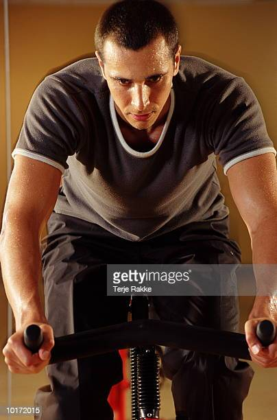 MAN IN GYM, CYCLING