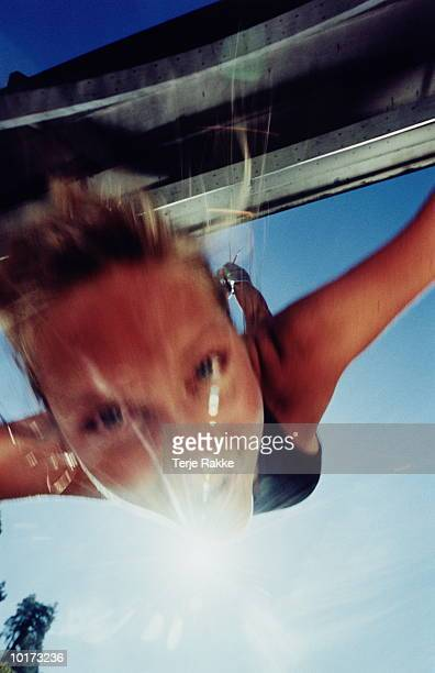 WOMAN BUNGEE JUMPING FROM BRIDGE