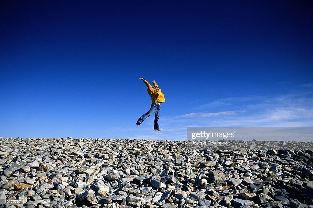 GIRL LEAPING ON BEACH, ACADIA NATIONAL PARK, MAINE : Stock Photo