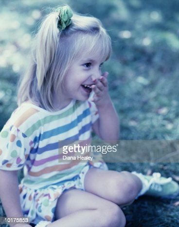 GIRL LAUGHING, 4YRS. CENTRAL PARK, NYC : Stock Photo