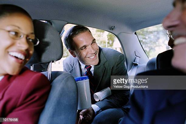 BUSINESSMAN ENTERING CAR WITH BRIEFCASE