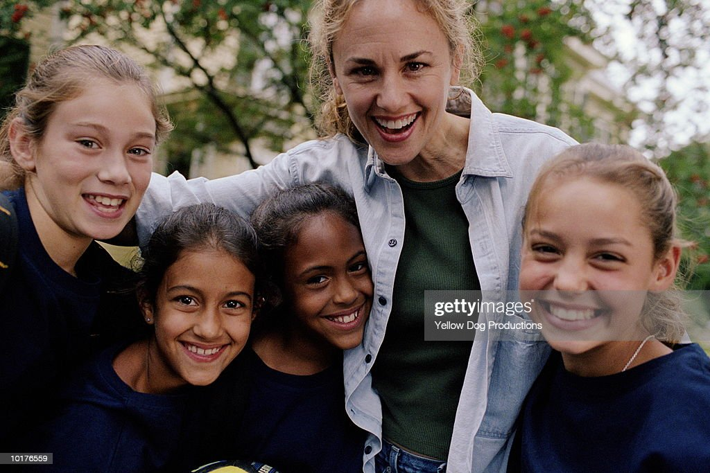 MOTHER WITH GIRLS IN SOCCER TEAM