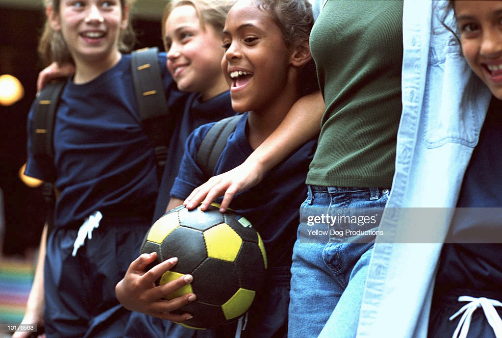 GIRLS IN SOCCER TEAM WITH ADULT WOMAN