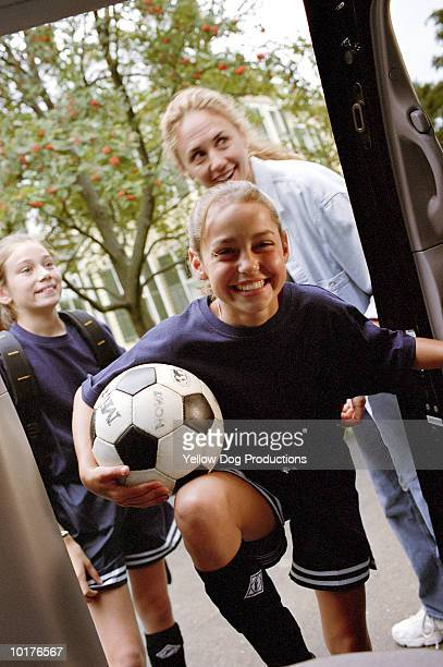 GIRLS GOING TO SOCCER PRACTICE WITH MOM