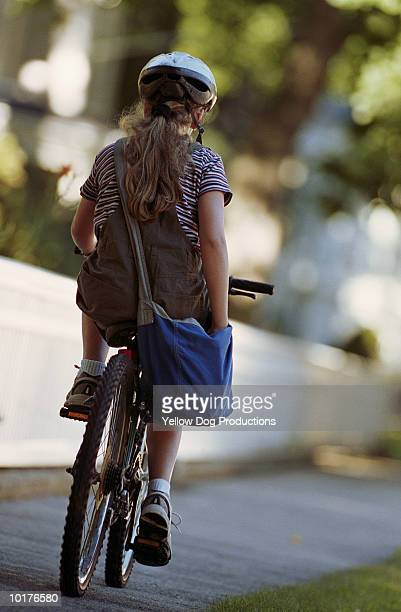 NEWSPAPER DELIVERY GIRL ON BIKE