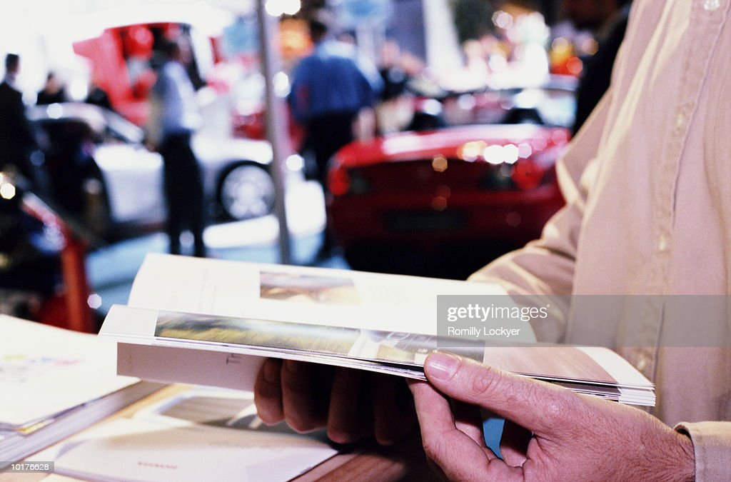 CONSUMER AT MOTOR CAR SHOW : Stock Photo