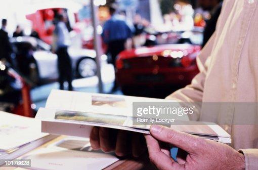 CONSUMER AT MOTOR CAR SHOW : Stock Photo