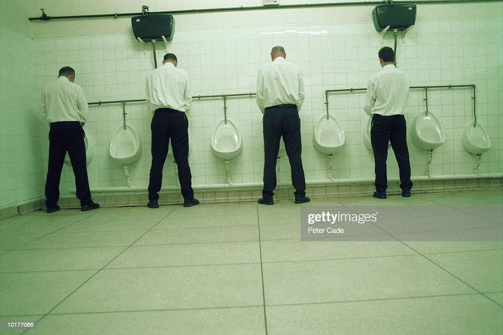 FOUR EXECUTIVES MEN IN RESTROOM