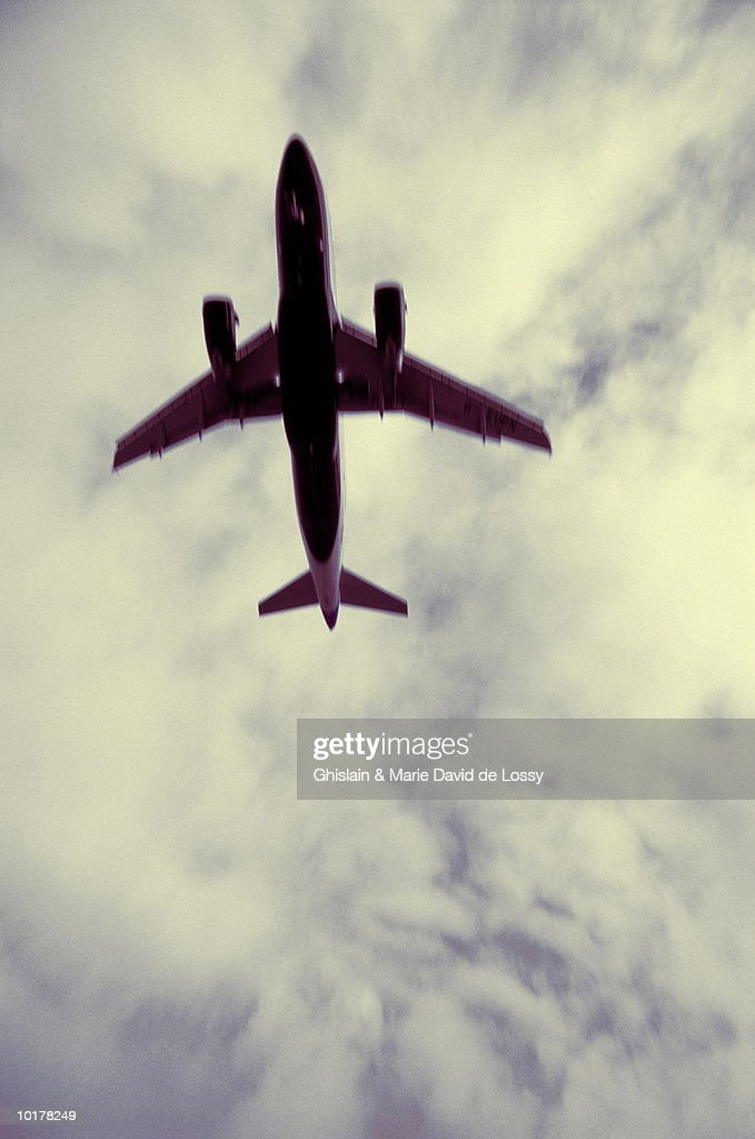 AIRPLANE IN SKY, VIEW FROM BELOW : Stock Photo