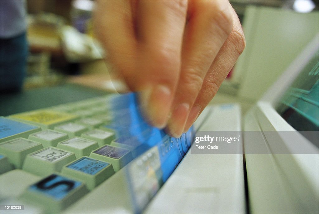 HAND SWIPING CARD THROUGH READER : Stock Photo