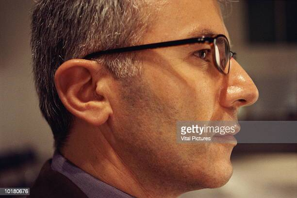 SIDE SHOT OF BUSINESSMAN, WITH GLASSES, CLOSE UP
