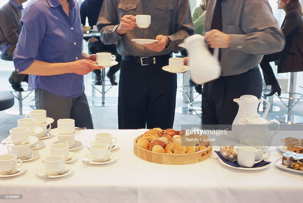 BUSINESS GATHERING PASTRIES ON TABLE
