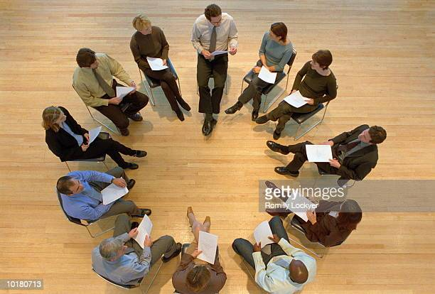 GROUP OF PEOPLE IN CIRCLE/MEETING