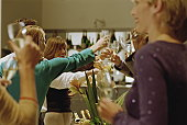 BUSINESS GATHERING PEOPLE TOASTING GLASS