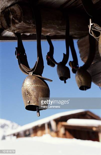 ROW OF COW BELLS ON CHALET, MURREN, SWITZERLAND