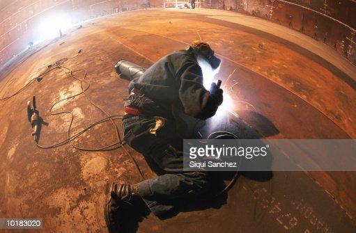MAN WELDING GAS TANK, BARCELONA, SPAIN : Stock Photo