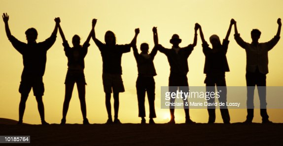 Silhouette Of People Holding Hands Arms Raised Stock Photo ...
