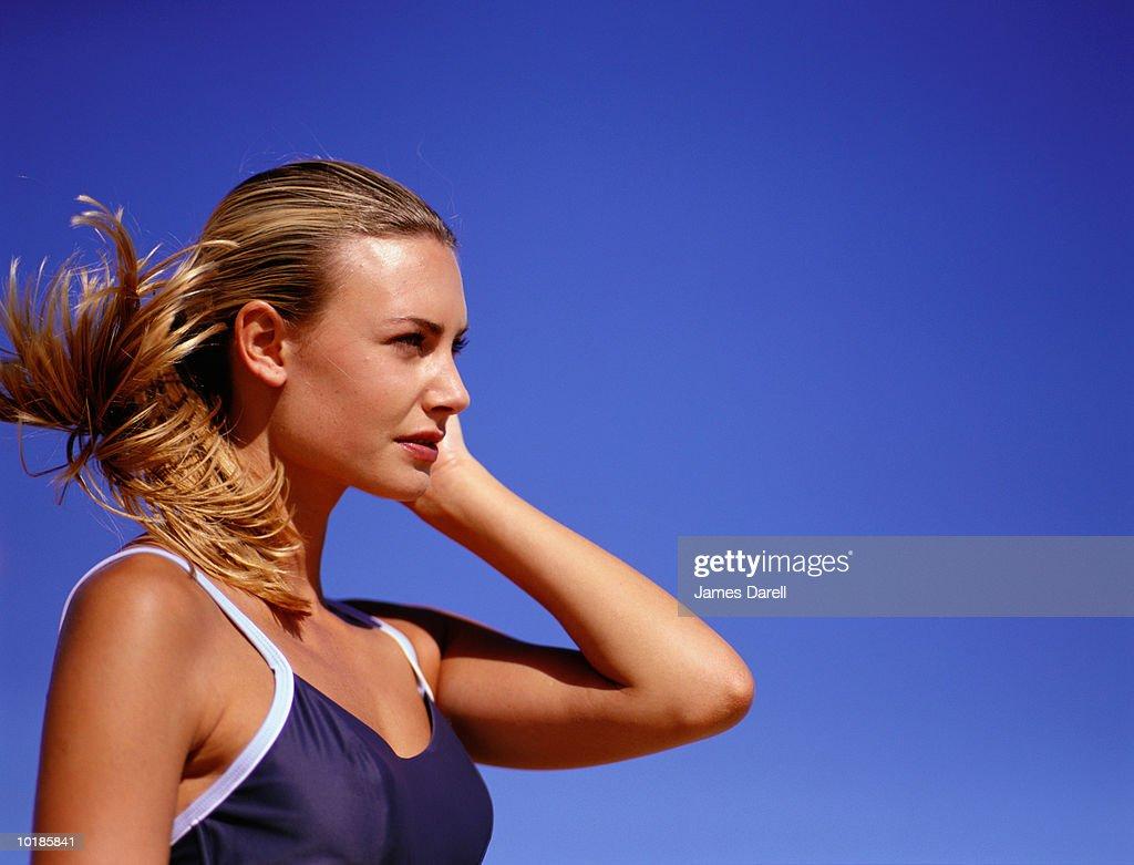 WOMAN IN SWIMWEAR, OUTDOORS, PROFILE, CLOSE-UP : Stock Photo