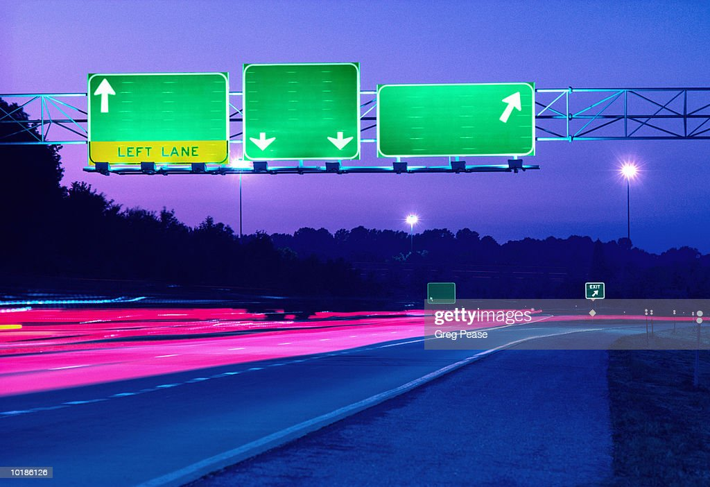 BLANK ROAD SIGNS ON HIGHWAY, DUSK : Stock Photo