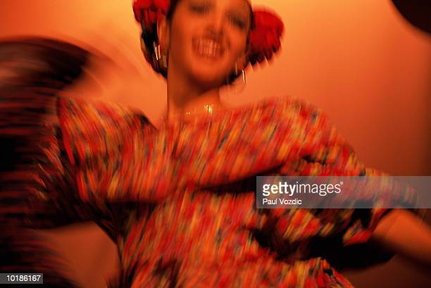 DANCER IN TRADITIONAL MEXICAN DRESS