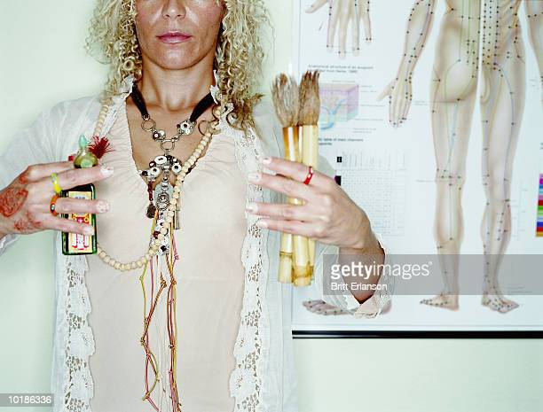 THERAPIST HOLDING OILS AND BRUSHES