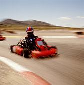 COMPETITIVE GO-CART RACING, BLURRED