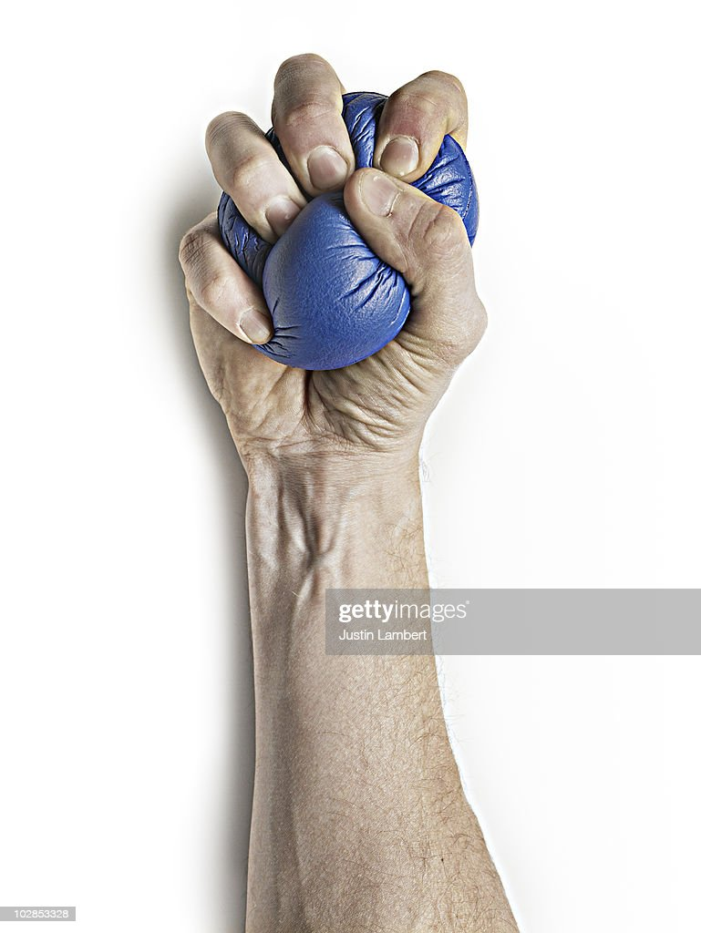 SQUEEZING STRESS BALL : Stock Photo