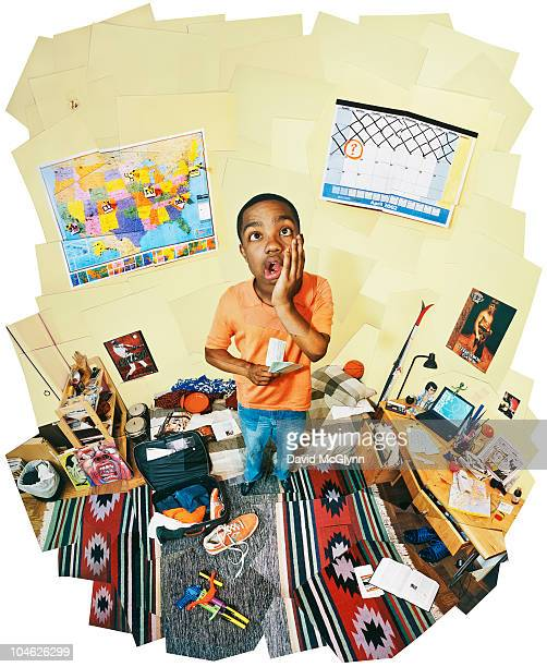 TEENAGE BOY IN BEDROOM