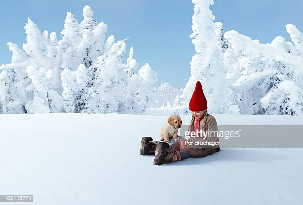ELF, PUPPY AND CHRISTMAS GIFT IN SNOWY FOREST