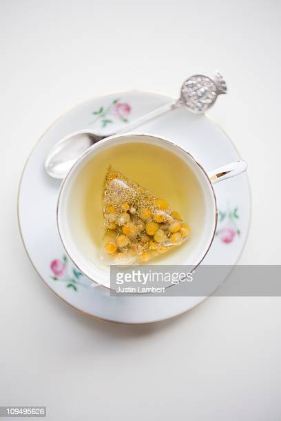CHAMOMILE TEA IN OLD FASHIONED VINTAGE TEACUP