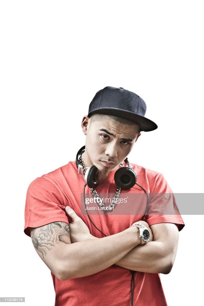 ORIENTAL YOUTH WITH ARMS CROSSED : Stock Photo