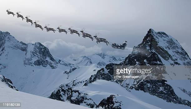 SANTA CLAUSE AND REINDEER  ACROSS THE MOUNTAINS