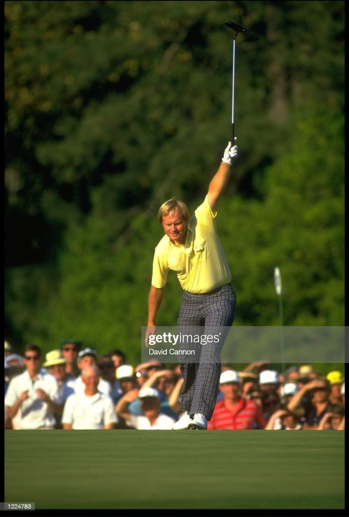 JACK NICKLAUS OF THE UNITED STATES HOLES A BIRDIE PUTT AT THE 17TH HOLE OF THE 1986 US MASTERS IN AUGUSTA GEORGIA NICKLAUS GOES ON TO BECOME THE...