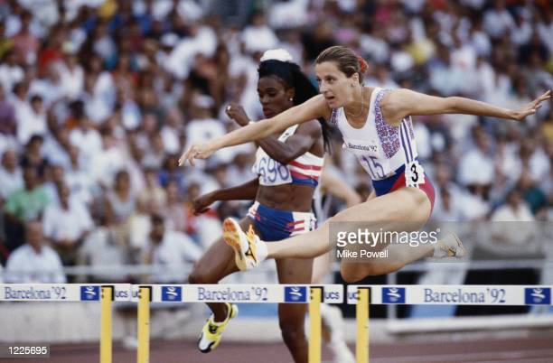 SALLY GUNNELL OF GREAT BRITAIN CLEARS A HURDLE AHEAD OF SALLY FARMER PATRICK OF THE UNITED STATES DURING THE WOMENS 400M HURDLE COMPETITION AT THE...