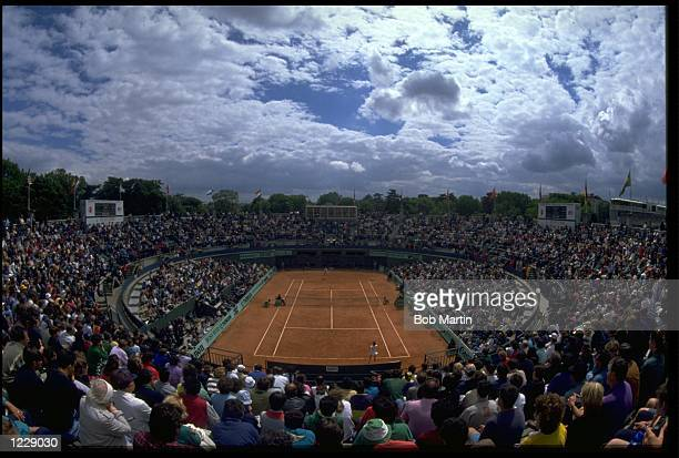 A GENERAL VIEW OF THE NUMBER ONE COURT AS THE SPECTATORS WATCH THE ACTION DURING A MATCH AT THE 1990 FRENCH OPEN PLAYED AT ROLAND GARROS IN PARIS