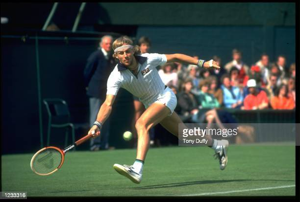 BJORN BORG OF SWEDEN REACHES LOW TO PLAY A SHOT DURING A MATCH AT THE 1981 WIMBLEDON TENNIS CHAMPIONSHIPS