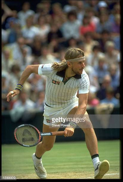 BJORN BORG OF SWEDEN GOES LOW TO PLAY A SHOT DURING A MATCH AT THE 1979 WIMBLEDON TENNIS CHAMPIONSHIPS