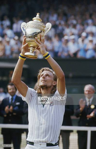BJORN BORG OF SWEDEN RAISES THE TROPHY ABOVE HIS HEAD AFTER WINNING THE MENS TITLE AT THE 1976 WIMBLEDON TENNIS CHAMPIONSHIPS BORG DEFEATED ILIE...