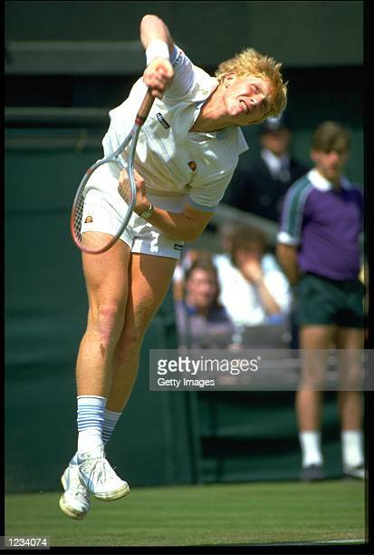 BORIS BECKER OF GERMANY SERVES DURING THE MENS SINGLES AT WIMBLEDON