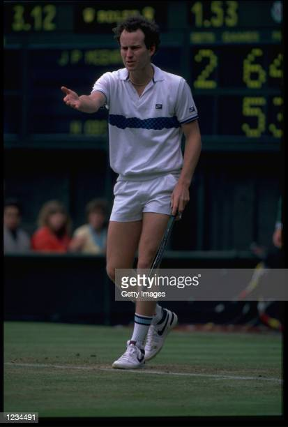 JOHN MCENROE OF THE UNITED STATES QUESTIONS A LINE CALL DURING THE MENS SINGLES AT WIMBLEDON