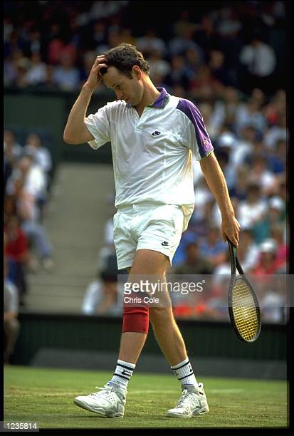 JOHN MCENROE OF THE UNITED STATES LOOKS DISTRAUGHT AT THE 1992 WIMBLEDON CHAMPIONSHIPS