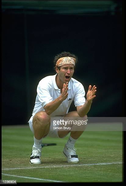 JOHN MCENROE OF THE UNITED STATES ARGUES WITH THE UMPIRE OVER A CALL OF OUT DURING THE 1991 WIMBLEDON CHAMPIONSHIPS