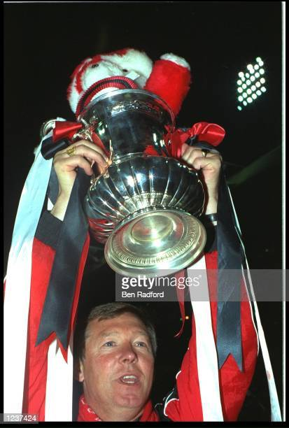 ALEX FERGUSON MANAGER OF MANCHESTER UNITED LIFTS THE FA CUP OVER HIS HEAD AFTER HIS TEAM DEFEATED CRYSTAL PALACE 10 IN THE REPLAY FINAL AT WEMBLEY