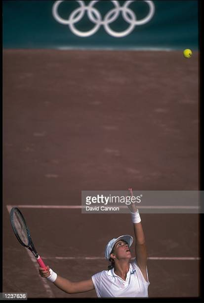JENNIFER CAPRIATI OF THE UNITED STATES TOSSES THE BALL HIGH IN THE AIR AS SHE PREPARES TO SERVE DURING THE WOMENS SINGLES TENNIS FINAL AT THE 1992...