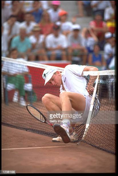MARC ROSSET OF SWITZERLAND CRASHES INTO THE NET DURING THE MENS TENNIS FINAL AT THE 1992 OLYMPICS IN BARCELONA ROSSET WON THE GOLD MEDAL AFTER...